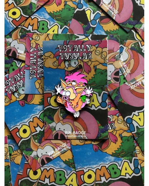 TOMBA! - TOMBA LEAPING ON A PIG ENAMEL METAL PIN BADGE BY TOTALLY TUBULAR